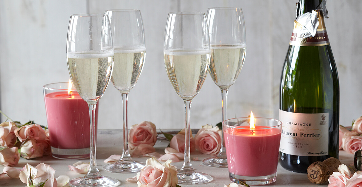 Valentine's Day Champagne with flower petals and candles.