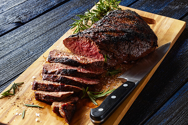 A Southern California Icon. A delicious grilled tri tip marinated in Bristol Farms Santa Maria seasoning, fresh herbs, and red wine. The staple main course for any catered event.