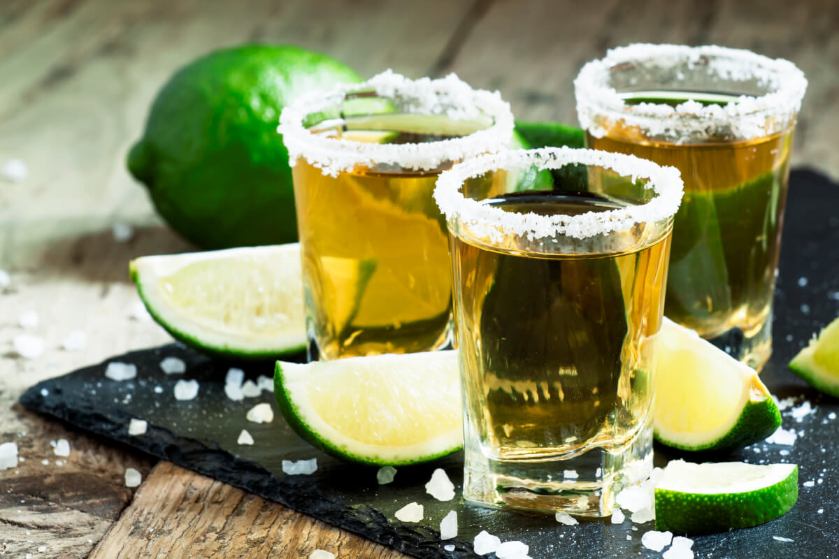 Tequila shots with salted rim and limes