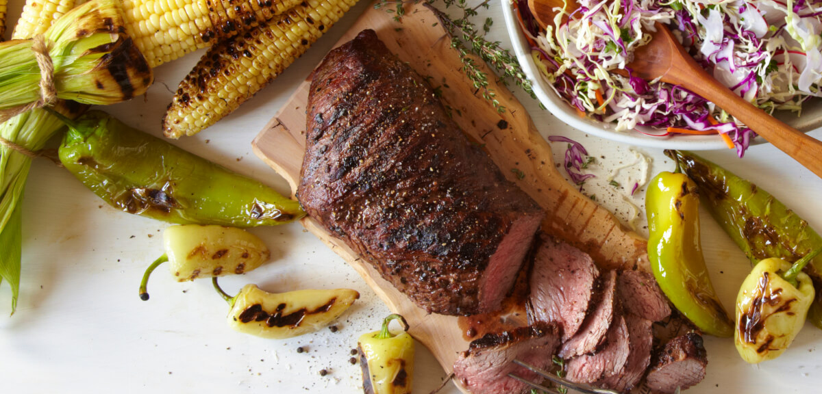 Tri Tip Steak with corn, peppers, and slaw