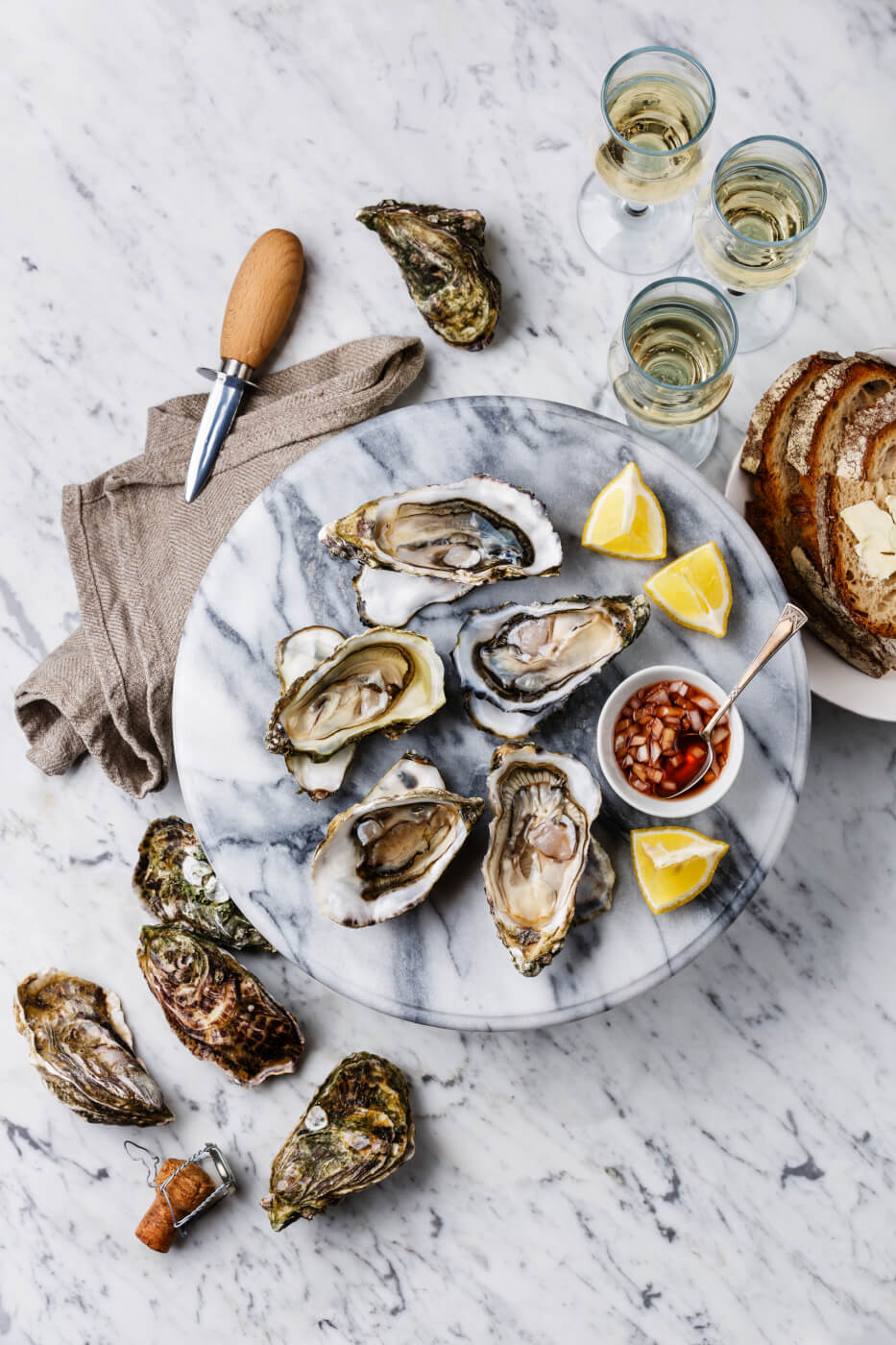 Oysters on marble background with lemon.