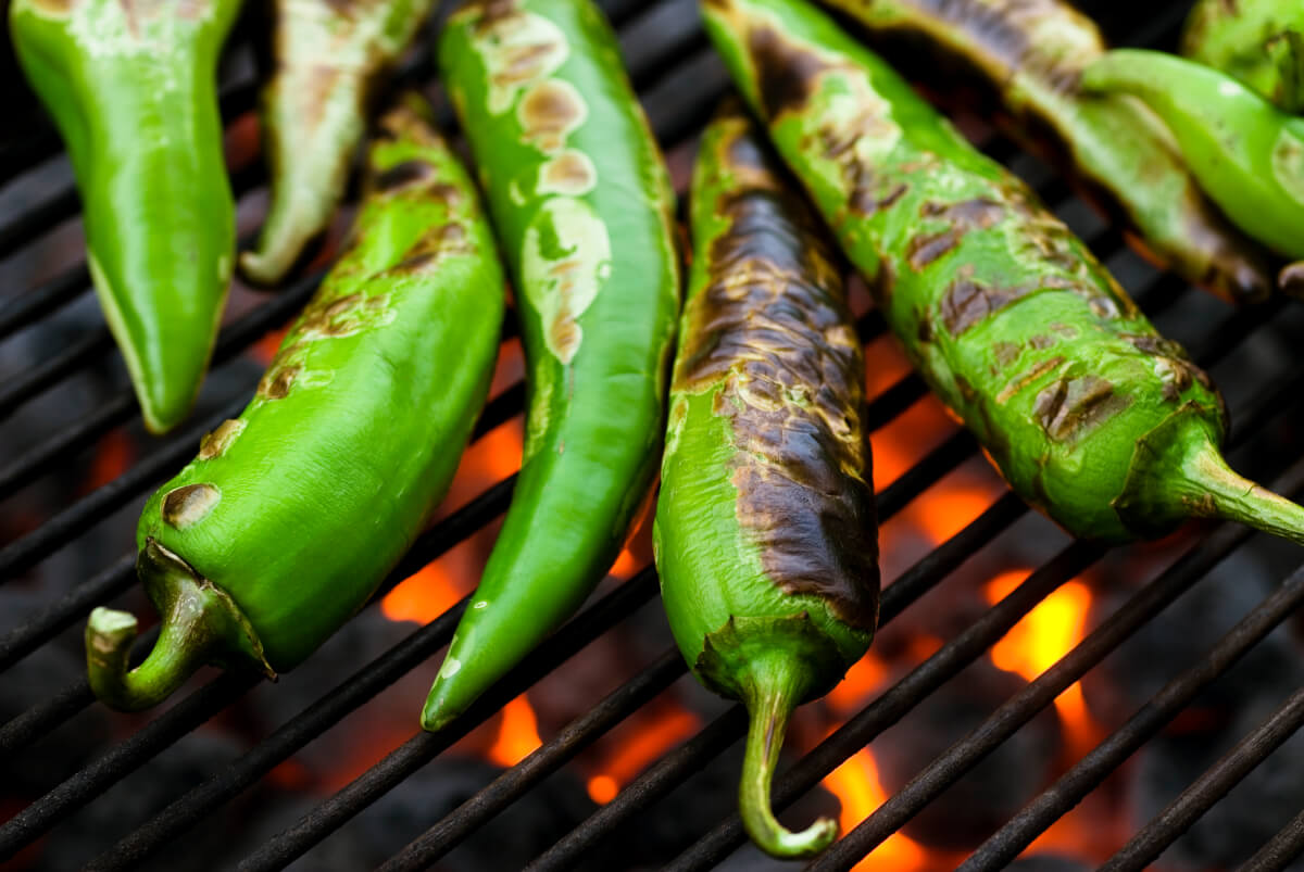 Hatch chiles roasting on the grill