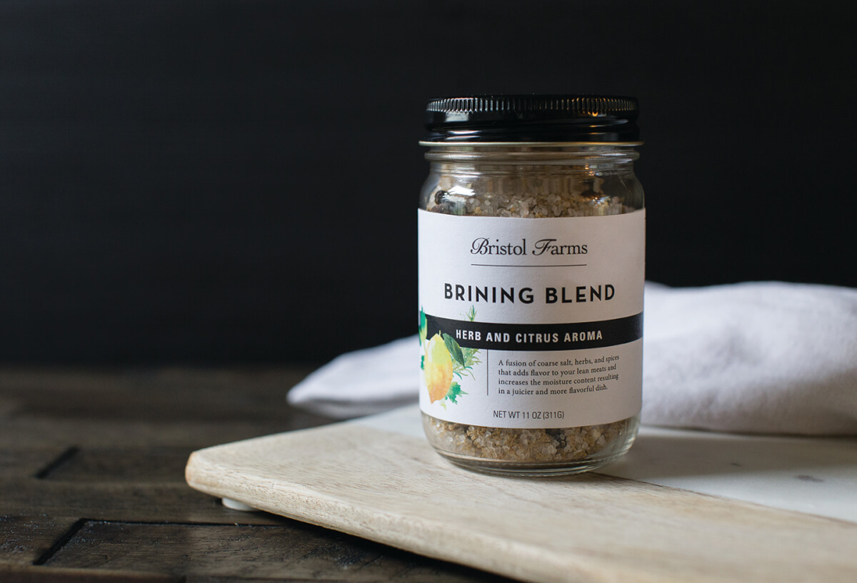Bristol Farm's Brining Blend on a wood cutting board.