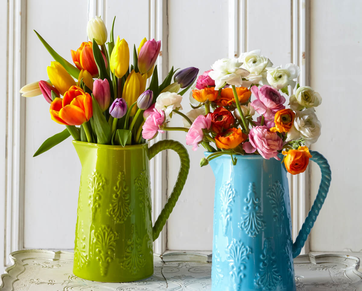 Bristol Farms' Tulips and Ranunculas inside a watering can.