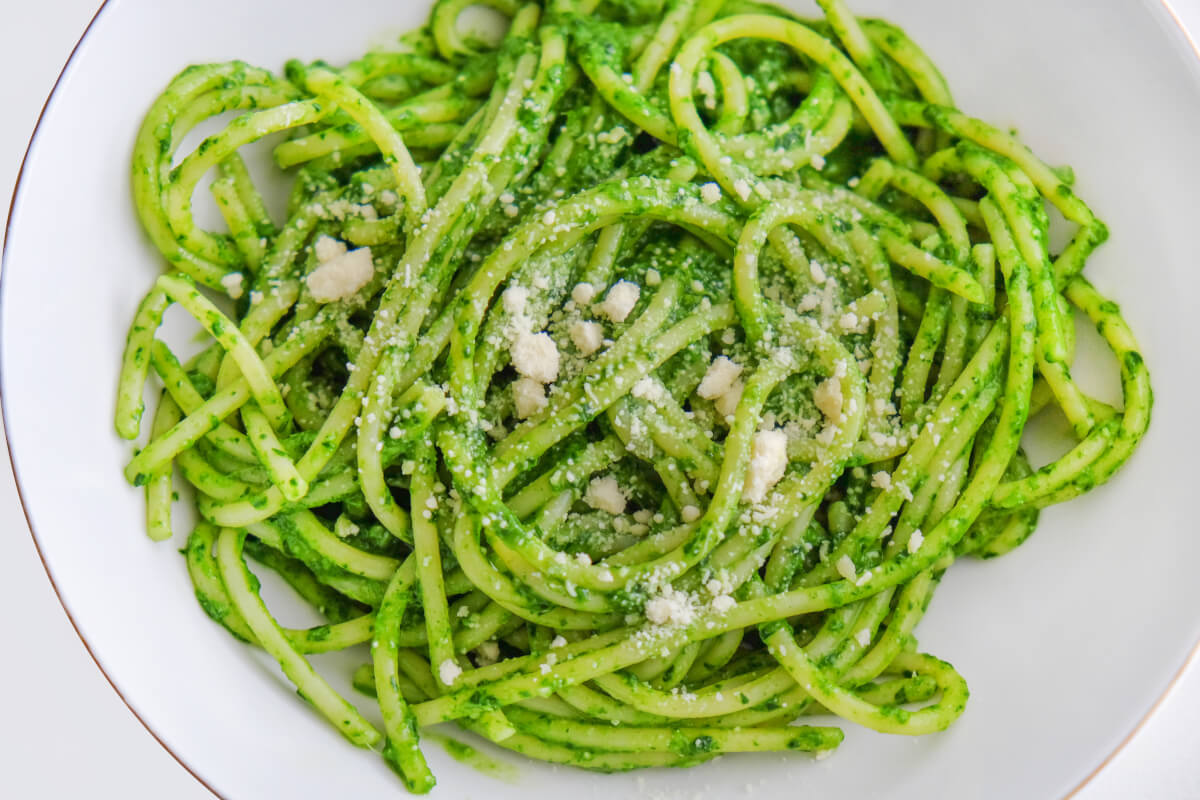 Freshly made mint and basil pesto tossed with pasta and garnished with parmesan.