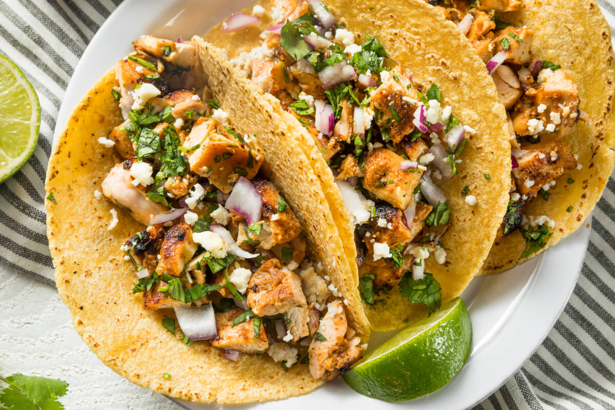 Vegan chicken tacos with onion and cilantro.