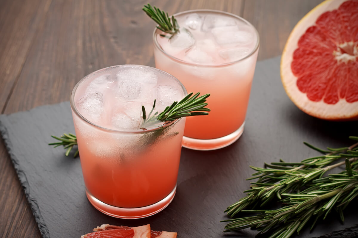 Grapefruit gin and tonic with a rosemary sprig and grapefruit  slice twist