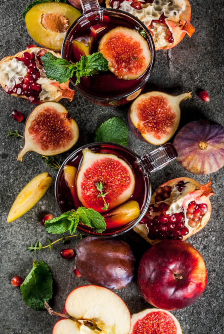 Fall Sangria with apples plums and figs.