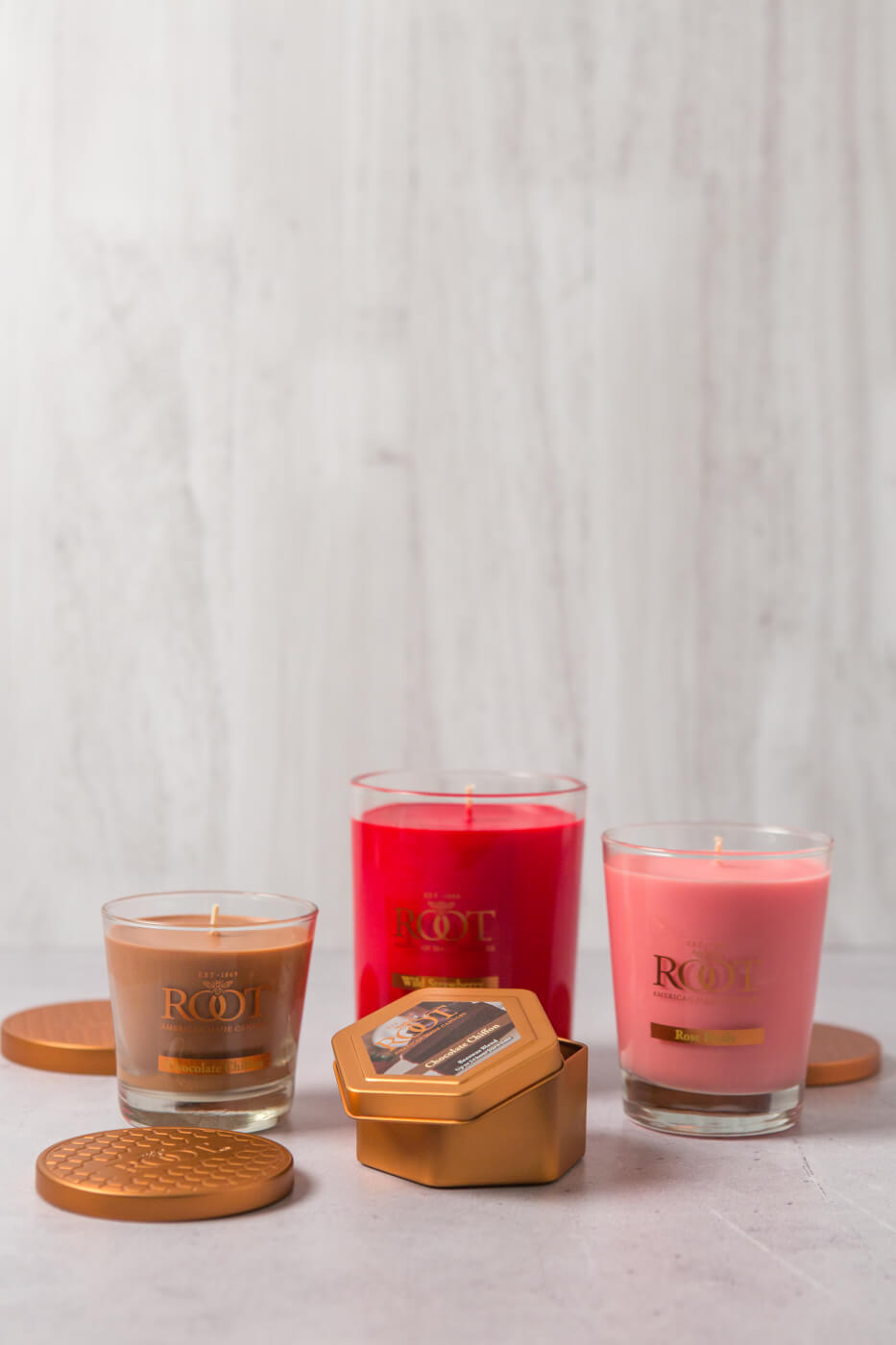 Group of pink and red candles from Root Candles