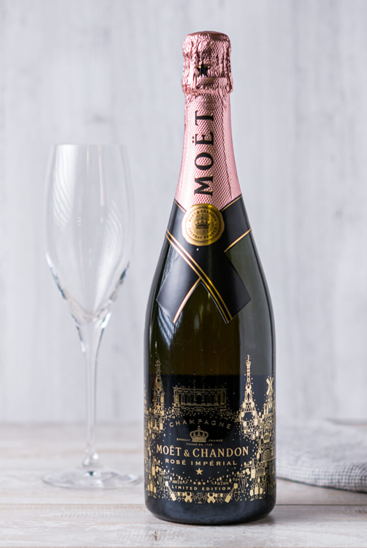 Bottle of Moet & Chandon Brut Imperial Rose with champagne glass
