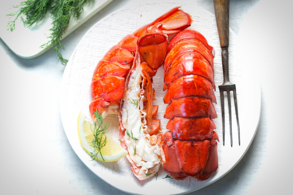 Lobster tails on a white plate